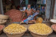 A market man in Galachipa, Bangladesh. Some vegetables, like onions, potatoes, garlic, turmeric are mostly sold in separate market stalls.