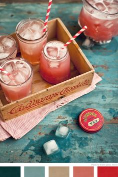 Vintage mason jars for drinks with fun and bright paper straws for a summer party!  Get them at The Party Fetti Shop.