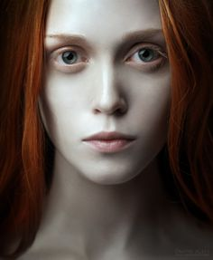 .love the contrast of her red hair against her pale face and blue eyes.