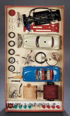 """Rare German Electric Car Set  21"""" (53 cm.) The two-car set is an elaborate feat that incorporated attached wires to a steering wheel that would allow a child to operate car direction and speed. The set is completely unplayed with and still remains tied within box in virtually mint condition. Included are two cars and all accessories and parts as well as instruction booklets and box. Germany,Schuco,circa 1950."""