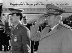 Original caption: Belgrade: Official Visit. Yugoslav president Tito, (R), and Libya's Colonel Muammar al-Khadafy salute during ceremony marking latter's arrival here, November 18, for an official visit. This is the Libyan leader's first such trip outside the Arab world since he came to power in 1969. The National News Agency said their talks would center on bilateral relations and cooperation and the Middle East situation.
