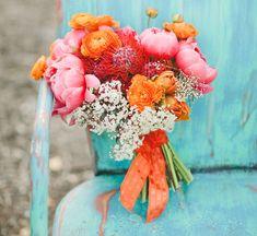 amazing flowers captured by our wedding photog Onelove Photography ..Orange Crush Wedding Inspiration