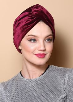 V-front turban made of red wne velvet. The turban is stretchy, light, and easy to wear! No tying involved, this turban is worn like a hat. Can be worn as a full or half head covering- tuck your hair in or leave it out!