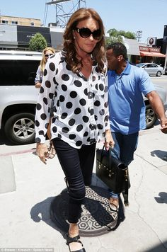 Polka time: Caitlyn Jenner was 'spotted' rocking a b&w-dotted blouse while filming her E! docu-series on West Third street in Los Angeles on Wednesday