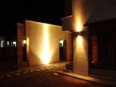 Pakistani house with exterior lighting... I like the shadow patterns on the stark walls