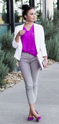 cropped printed pants, fuchsia shoes and top, a white blazer