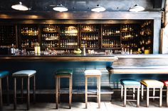 An eclectic bar in San Francisco with mix-and-matched stools