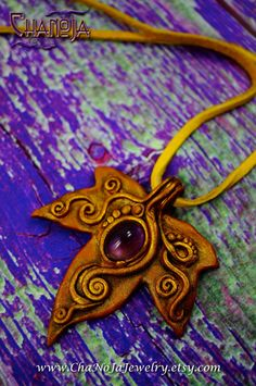 Leaf Pendant Sacred Realms amethyst polymer clay leaf pendant by ChaNoJaJewelry on etsy
