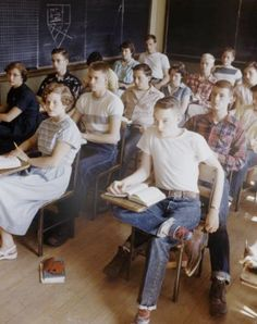 1950's ..... look at that little rebel with the plain white t-shirt, but wait, he's on the front row...not too rebellious.