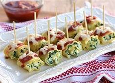 Lasagna roll-ups: lasagna noodles, spinach, ricotta cheese, Parmesan cheese, egg, garlic, Italian seasonings, pizza sauce, shredded mozzarella, salt, pepper
