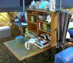 Camping Kitchen with compartment sized for silverware tray.