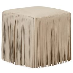 Intriguing texture and suave style converge to form the Cassidy ottoman. A curtain of long fringe creates visual interest along the cube design, while supple leather in a choice of hue adds a rich accent to modern spaces. Available in several finish and fabric options; Shown in: Nature Linen leather; Recessed casters; Fabric samples are available to assist you in making your fabric selection by emailing your request to swatches@zincdoor.com; Overall: 18in W x 18in D x 18in H; Seat: 18in H