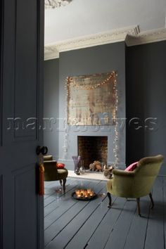 Tray of candles and champagne on floor in dark grey painted living room with fairylights draped arou Painted Wooden Floors, Painted Floorboards, Grey Wood Floors, Grey Flooring, Grey Floorboards, Distressed Wood Floors, Distressed Mirror, Painted Walls, Style At Home