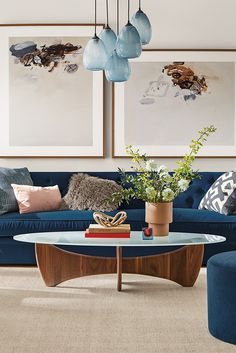 This coffee table features a wood base and a glass top, so you can always see the sculptural ash base. Modern Coffee Tables, New Furniture, Oval Coffee Tables, Ottoman In Living Room, Furniture, Modern Furniture Living Room, Home Furniture, Coffee Table, Home Decor