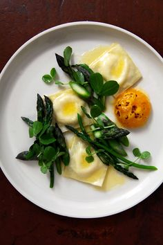 Ricotta ravioli with asparagus brûléed duck egg, pea tendrils and butter