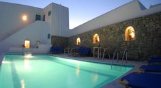 Asteri Apartments & Suites Ornos Asteri Apartments & Suites is situated in Ornos. It offers from port/airport transfer on request, a 24-hour front desk and an outdoor pool. The nearby Corfos Beach (150 metres) is ideal for summer sports like kite surfing.