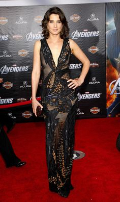 Cobie attended the Hollywood premiere of The Avengers last night wearing this copper and black, Donna Karan sequined gown with a plunging neckline.    The brunette beauty finished her look with Brian Atwood heels, Coomi earrings and a copper Judith Leiber clutch.