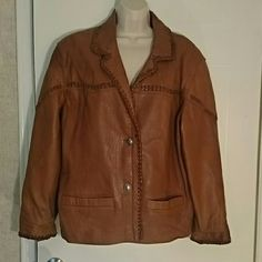 """Guess Leather Jacket Brown satin lined leather jacket by Guess. Beautiful leather detailing throughout. Two metal buttons stamped Guess. Two front pockets. Measures 25"""" in length from shoulder seam. Sleeves measure 25"""" from shoulder seam. Gorgeous jacket! Guess Jackets & Coats"""