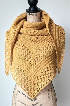 Knitting pattern for Pumpkin Spice Shawl - Pumpkin Spice is an oversized shawl that's knit in worsted weight yarn. The designer says that this pattern is a great option for those who are fairly new to shawl construction and/or to lace. It is written only (no charts), easily memorized and works up quickly. Designed by Kaylyn Bugay