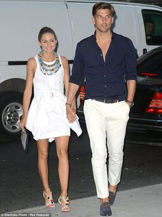 Nice accessories: Olivia carried a simple handbag and wore her hair in a slick 'do while Johannes looked handsome in navy shirt, white trousers and blue suede shoes