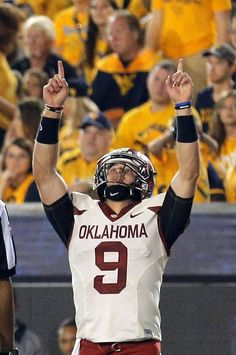 Oklahoma's Trevor Knight (9) celebrates a touchdown in the fourth quarter during the college football game between West Virginia Mountaineers and the University of Oklahoma Sooners at Milan Puskar Stadium in Morgantown, W.Va., Saturday, Sept. 20, 2014. Photo by Sarah Phipps, The Oklahoman