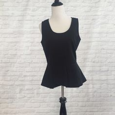 Form fitting peplum top! This tank is perfect for a night out! Excellent condition. I purchased on ModCloth. **no size tag** Tops Blouses