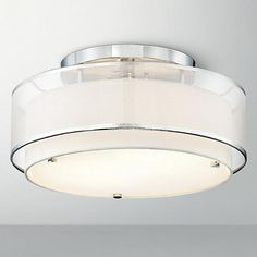 Dazzle a room with the contemporary pizzazz of this double drum flush mount fixture, by Possini Euro Design.