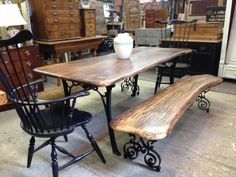 Custom table and bench set. Wrought iron scroll legs and solid single piece wood tops naturally shaped to bring out their original beauty.