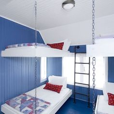 Industrial meets nautical in this Stone Harbor, New Jersey, beach house bunk room. A ladder constructed from plumber's pipe gives kids access to the top bunk, and metal chains act as decorative supports. The red, white, and blue color palette lends a patriotic vibe.
