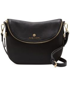 """Streamlined with a shapely leather silhouette, this Vince Camuto crossbody bag offers a custom fit via the slender adjustable strap.   Imported   Leather   Crossbody strap with 23"""" drop   Fold-over fl"""