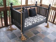 Have a old crib laying around or drive by a garage sale of one cheap....make it into a porch swing with comfy throw pillows and a fitted sheet over the mattress for the cushion.