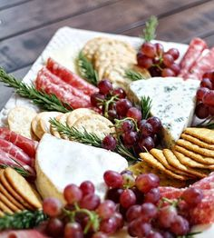 Garnish salami roll ups and nice cheeses with rosemary and a variety of crackers for an elegant look... Don't forget the grapes!