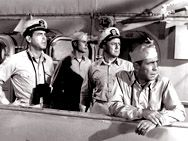 1954 Humphrey Bogart, Van Johnson, Fred MacMurray and Jose Ferrar in The Caine Mutiny.  It's a superb film.  Is the captain, played by Bogey, insane or not?  Either way, I cannot see or say strawberries without hearing his voice in my head.  Watch it yourself.