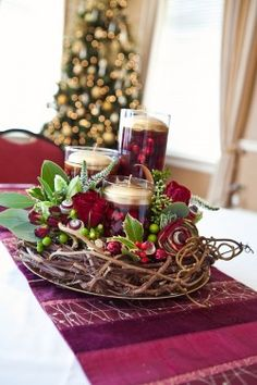 floating cranberries and gold candle