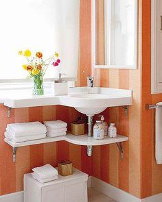Lavamanos en esquina para baños pequeños. Repiza bajo el lavamanos