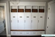 "love the closed ""lockers"" with shelf above and drawers underneath, with small bench"
