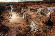 Grand Falls of Northern Arizona. A natural waterfall located 30 miles northeast of Flagstaff, Arizona in the Painted Desert on the Navajo Indian Reservation. It is 185 feet high.