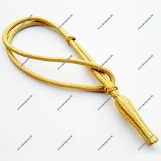 Gold Mylar Wire Sword Knot  http://www.elandgroup.biz/c142_Accessories-Accoutrements/c322_Sword-knots/i6779_Gold-Mylar-Wire-Sword-Knot.html#.VrhJ_Bh97IU  www.elandgroup.biz/   info@elandgroup.biz