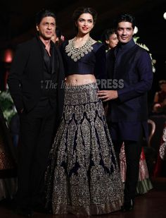 Deepika in 1930's inspired wedding collection by Manish Malhotra http://www.manishmalhotra.in/flash.html @ PCJ Delhi Couture Week, Aug, 2013 (in a navy blue velvet zardozi lehenga teamed with full puffed sleeved choli, with SRK & Manish) (IE Photo: Tashi Tobgyal)