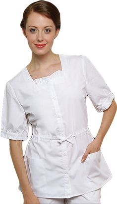 Style Code: (AD-621)  This hostess top is as beautifully constructed as it is delightful to look at and wear. A pleated ruffle nestles in the square neckline and a drawstring tie cinches the waist. Self binding creates a frill at sleeve edge and two patch pockets keep the whole thing practical.