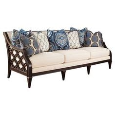 """Brimming with sophisticated style, this hardwood-framed sofa features a swoop-arm silhouette and latticework paneling.   Product: SofaConstruction Material: Hardwood and cotton-polyester blendColor: Dark brown, cream and blueFeatures:  Turned front legsHandmade Note: Accent pillows are not includedDimensions: 38"""" H x 91"""" W x 42"""" D"""