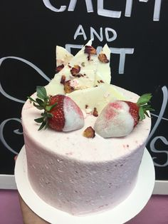 VIPink cake- strawberry cake topped with strawberry buttercream and topped with chocolate dipped strawberries and chocolate bark