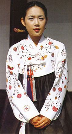 Young woman wearing hanbok, the traditional Korean costume (for embroidery idea purposes)