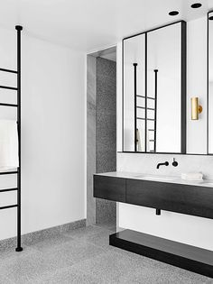 Contemporary black and white bathroom via Flack Studio