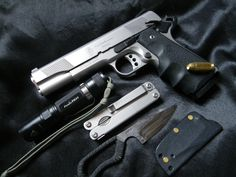 submitted by Nicolas  -Fred Perrin Neck Bowie-Sw 1911 .45 acp-Fenix PD 31 flashlight-Leatherman Side-clip