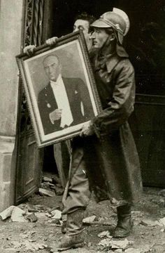 Fireman retrieving a picture of the great Turkish leader Mustafa Kemal Ataturk from a fire 1953 Turkey History, Turkish Army, History Quotes, World War I, American Horror, Ancient Egypt, Wall Design, Istanbul, Artsy
