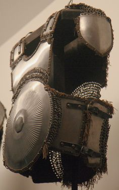 Armour of the Ottoman Empire. 16th to 17th century krug (chest armor), Armour of the Ottoman Empire. 16th to 17th century krug (cuirass/chest armor), as worn by fully armored cavalryman in conjunction with migfer (helmet), dizcek (cuisse or knee and thigh armor), zirah (mail shirt), kolluk/bazu band (vambrace/arm guards), and kolçak (greaves or shin armor). Les Invalides  Museum of Arms and Armor, Paris France.