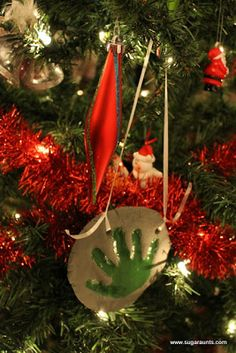 25 days of Christmas Play almost coming to an end!  Day 24 is handprint ornaments!