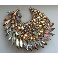 Very large Sherman brooch set with AB Swarovski crystals  and set in gold plate .