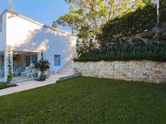 Eco Outdoor Coolum limestone walling and Capri travertine flooring used in Mediterranean inspired garden. …
